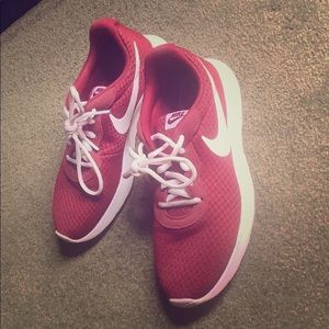 Gently used maroon Nike running shoes